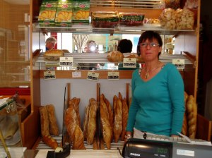 Madame Pittino in front of her bread selection. I'm behind the flash. Jimmy has just spotted the pastries.