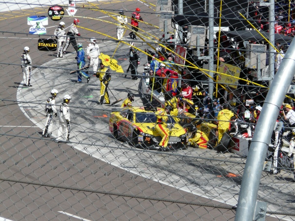 Pit stop mayhem. Note the fishing poles to coax drivers in. Wouldn't it be fun to mix them up?