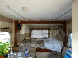 Bed slide in travel trailer