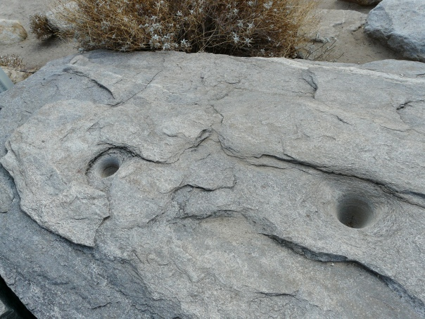 Ancient Indian mortar in rock