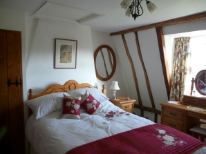 timber-framed bedroom